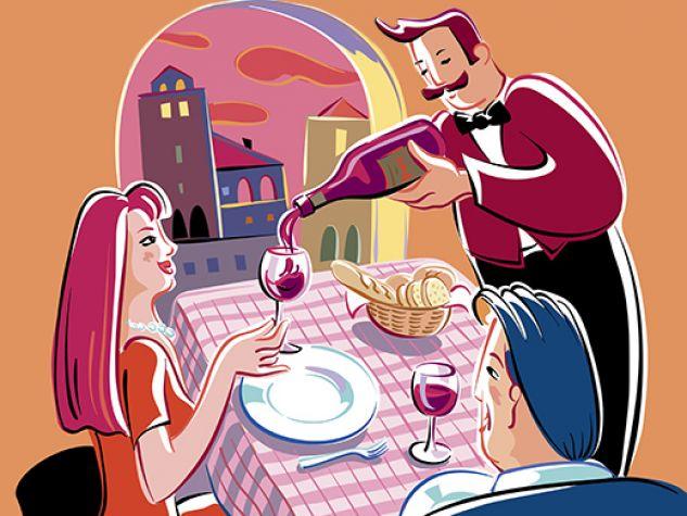 un sommelier serve del vino rosso