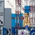 Venezia, Porto Marghera. Cartelli stradali riassumono in poche parole alcune delle attività della zona portuale. Tra cui le renfuse. - © Giorgio Boato